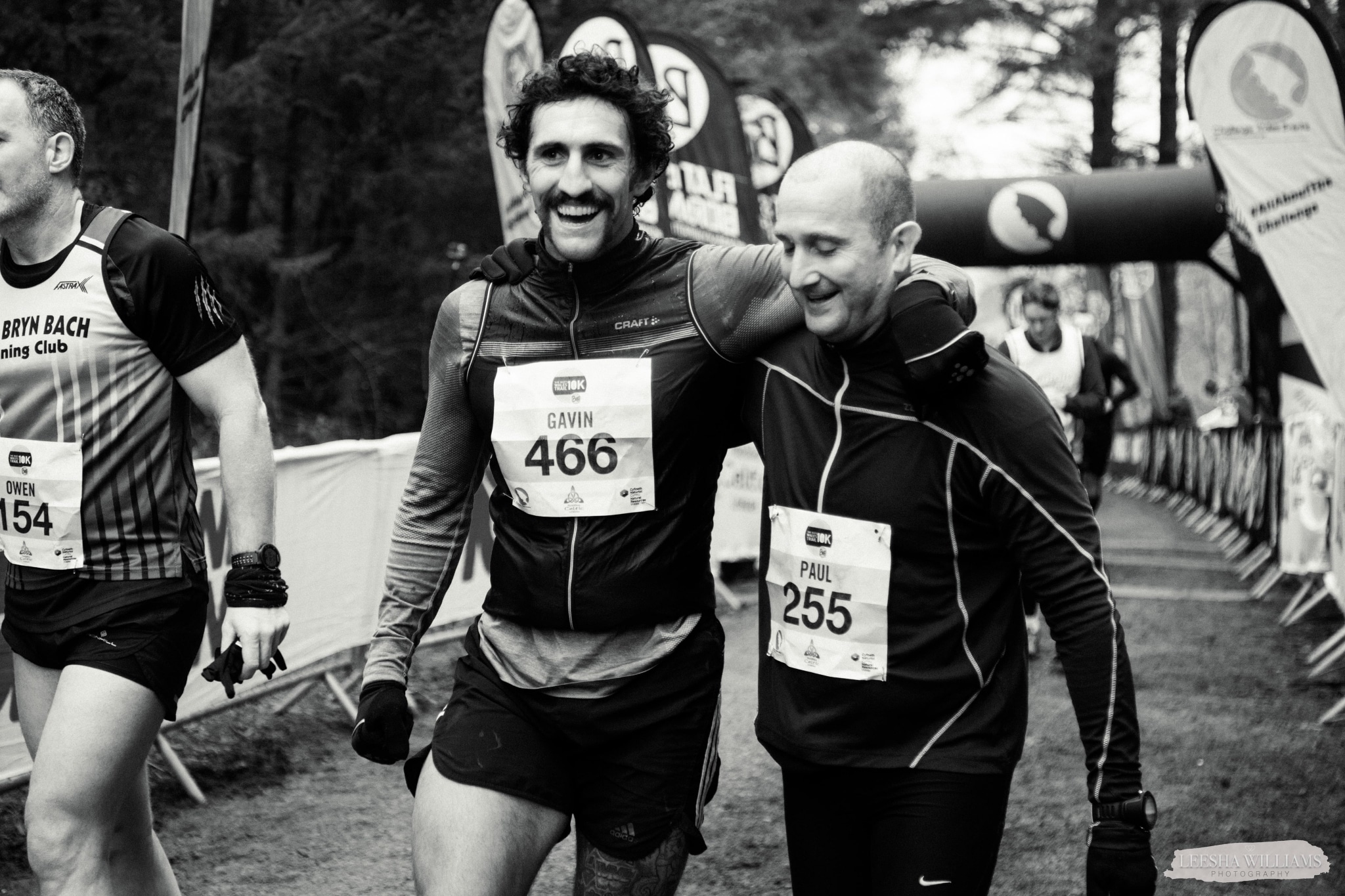 Two runners hug with big smiles after Finishing the Buff Wales 10k- What you need to know about Tough Runner UK is we produce the challenge you crave.